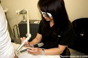 Tattoo Removal Process. Cold air with laser set for maximum results.