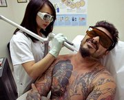 Claire during Laser Tattoo Removal process...  No Pain? No Gain!
